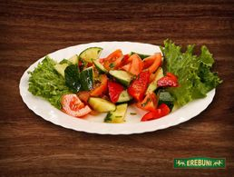 Salad from fresh vegetables with oil